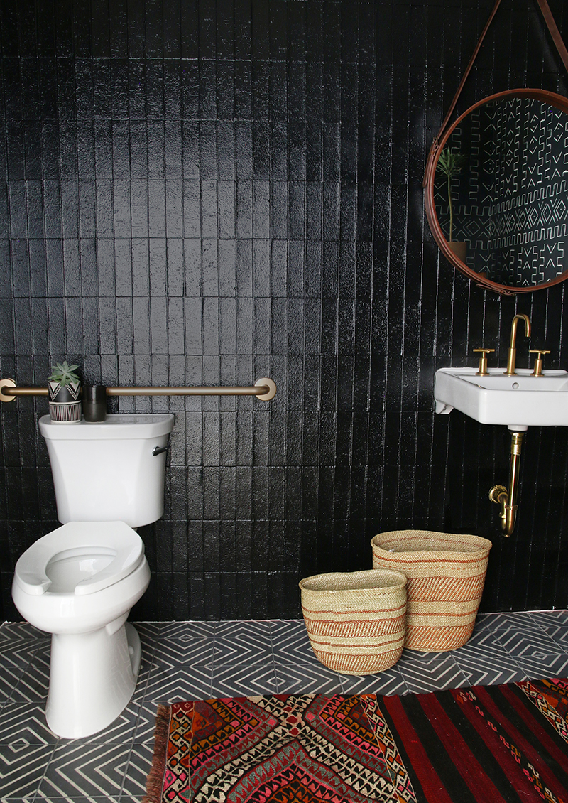 Amber interiors x kohler new office bathroom amber for Black tile bathroom designs